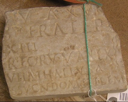 Fragment of a tombstone with Latin inscription