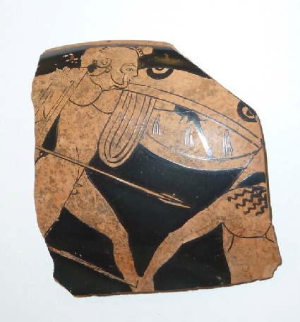 Attic red-figure pottery stemmed cup fragments depicting a battle scene