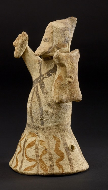 Toy figurine of a warrior with shield and dagger