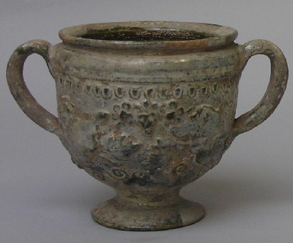 Green-glazed cup decorated with moulded leaves