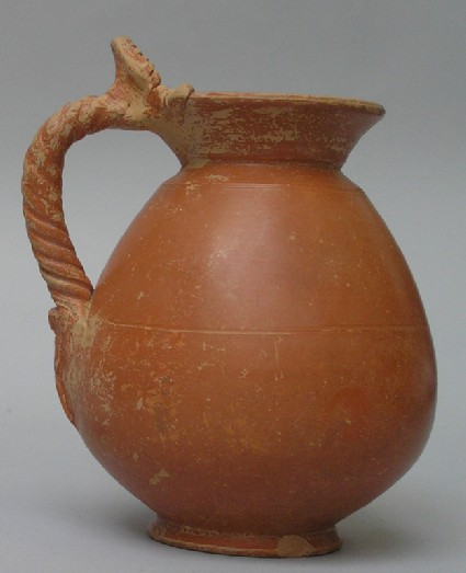Red-slipped jug with head of Mercury at the top of its twisted handle