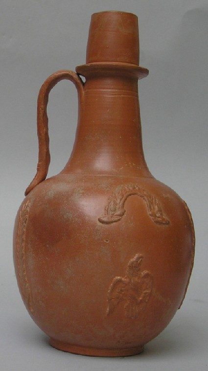 African red slip ware flagon with applied decoration of man, bird, palms and garlands