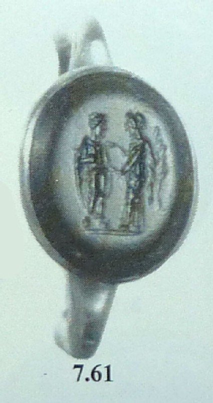 Betrothal ring engraved with couple holding hands
