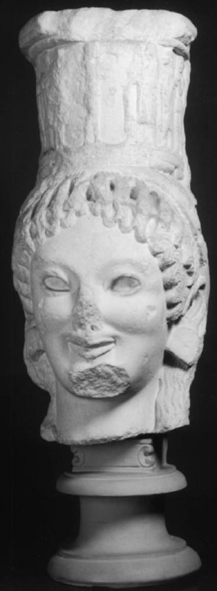 Cast of head of caryatid from unknown treasury at Delphi