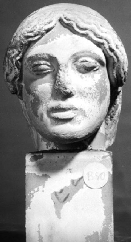 Cast of a small female statue head
