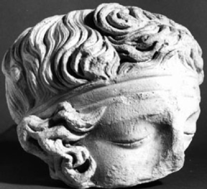 Cast of a head fragment with closed eyes from Rome