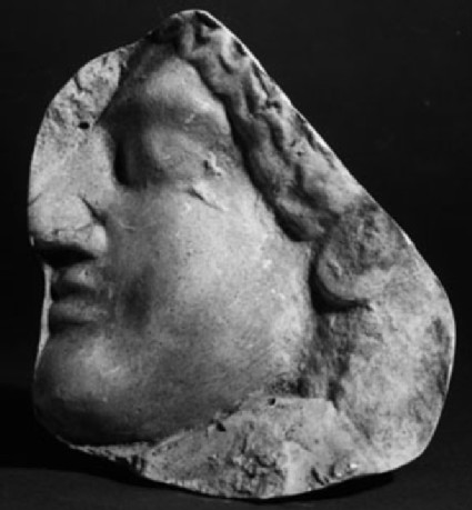 Cast of a relief of a miniature profile mask of a woman, from Agrigento