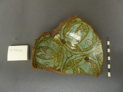 Base fragment of a bowl with palmettes