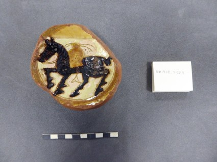 Base fragment of a bowl with horseman