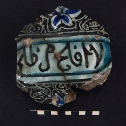 Base fragment of a vessel with inscription