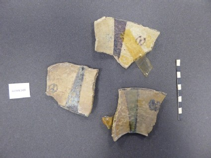 Three fragments of a vessel with radiating lines