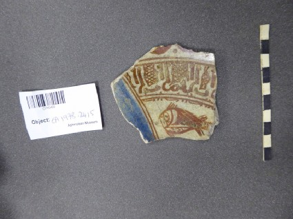 Fragment with inscription and fish