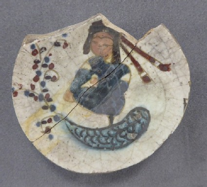 Base of a vessel with seated figure and fish