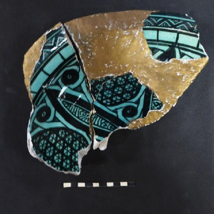 Rim fragments from a plate with zig zags and cross-hatching