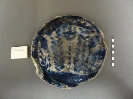 Base fragment of a vessel with vegetal motifs