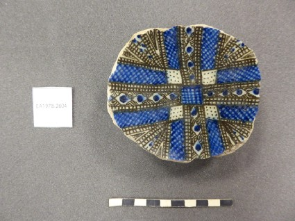 Base fragment of a bowl with radiating design