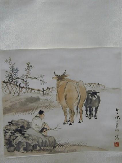 Herd boy, cow and calf