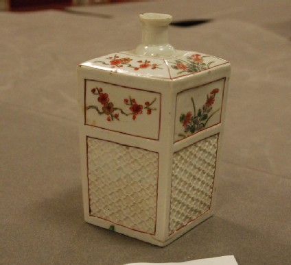 Square bottle with basketwork decoration and floral sprays