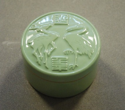 Lidded box with relief design of deer and crane