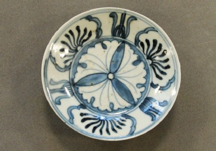 Dish with formal floral design around gingko leaves