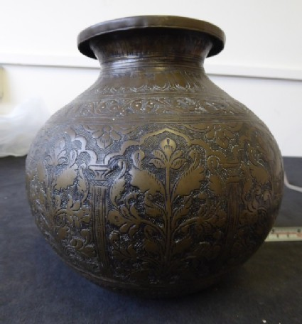Lota, or water vessel, with flowering plants within cusped arch surrounds