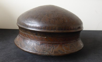 Circular lidded box with, trees, plants, and animal motifs