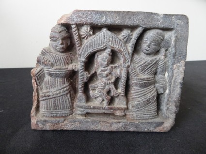 Brick fragment depicting Krishna and attendant couple in relief