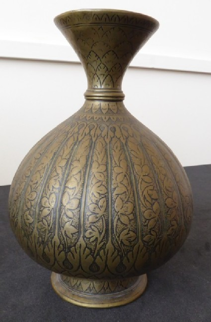 Round-bodied lota, or water vessel, with vertical bands depicting plant forms