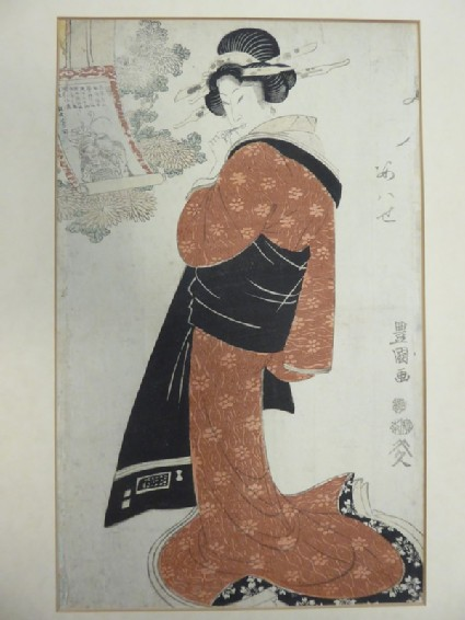 Woman looking at a scroll