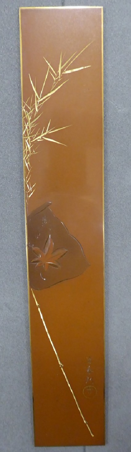 Plaque in the shape of tanzaku, or wish ships, poetry card with design of bamboo with flag depicting maple leaf