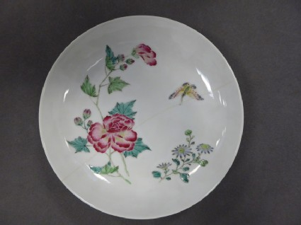 Saucer dish decorated in famille rose enamels with peonies