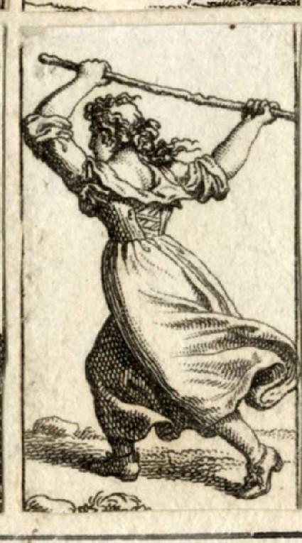 A woman raising a stick above her head