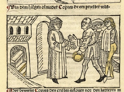 A clergyman meets a group of people