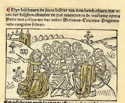 A group of clergymen sitting in nature with books