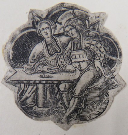 A man and a woman seated at a table