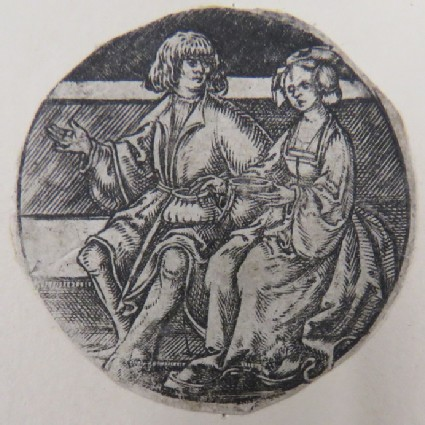 A couple seated on a stone