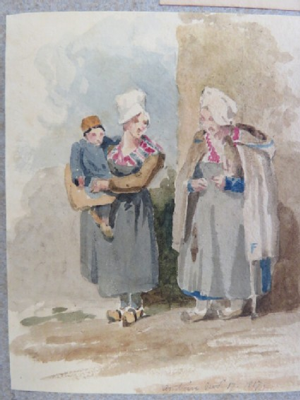 Two women in clogs, one holding baby