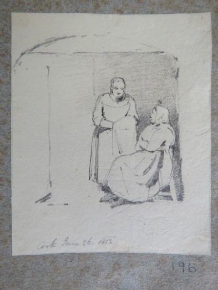 Two women in an alcove, one seated