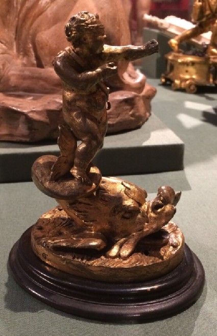Fountain head in the form of Cupid, blindfold, riding a dolphin
