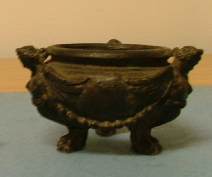 Inkwell (or basin) supported by three sphinxes