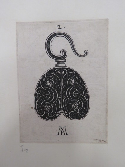 Design for a hook for a scabbard or sword in shape of a heart, decorated with foliate scrolls and flowers on black background, from Douce Ornament Prints Album I