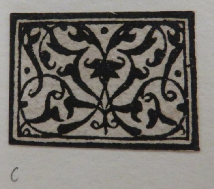 Small rectangle medallion with an arabesque crewelwork design in black with two concentric rectangles at border, from Douce Ornament Prints Album I