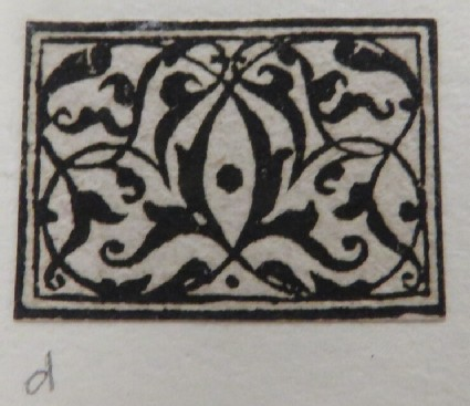Small rectanglar medallion with an arabesque crewelwork design in black with two concentric rectangles at border, from Douce Ornament Prints Album I