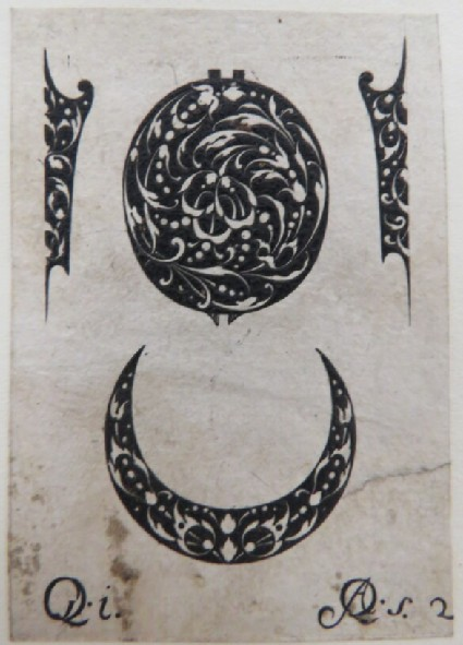 Central medallion with two fillet shaped ornaments and one crescent shaped ornament decorated with arabesque foliage in blackwork, from Douce Ornament Prints Album I