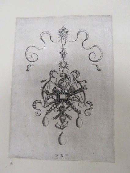 Pendant design with central gem surrounded by trophies of crossbows, quivers, arrows, helmet, pair of gantlets, and horn, with three drop pearls, from Douce Ornament Prints Album I