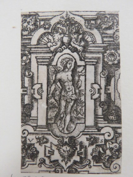 Adam holding tree truck and covering himself in centre of a decorative niche surrounded by strapwork, foliage, grotesque animals, and trophies, from Douce Ornament Prints Album I