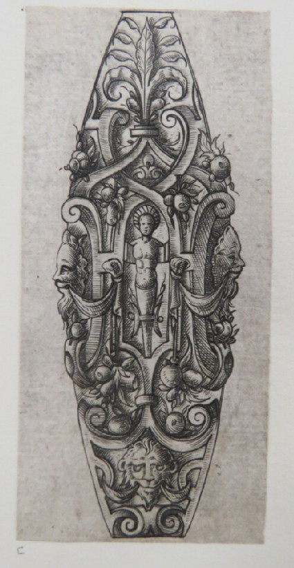 Almond-shaped ornament for dagger grip with herm in centre surrounded by strapwork, grotesque masks, foliage and fruit, from Douce Ornament Prints Album I