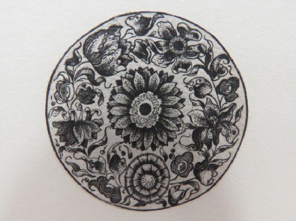 Circular medallion possibly for a box lid or watch case with large sunflower in centre surrounded by a flower chain composed of several varieties of flowers, from Douce Ornament Prints Album I