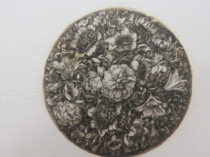 Large medallion possibly for a box lid or watch case decorated with a large variety of naturalistic flowers on a black fround, from Douce Ornament Prints Album I