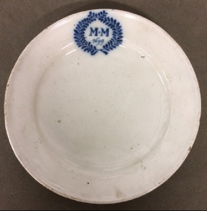Plate with M.M over 1699 within laurel wreath